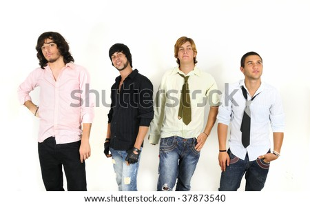 Portrait of young trendy group of male friends standing - isolated - stock photo