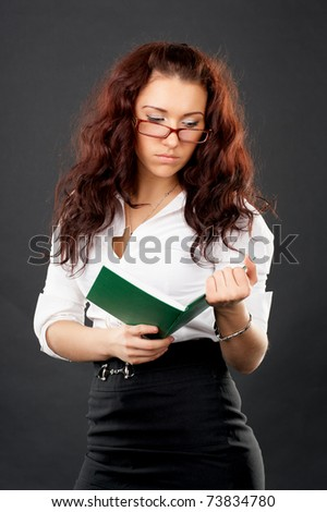 Portrait of young university girl reading book