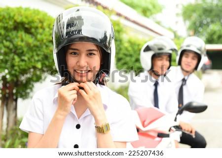 Portrait of young wearing a helmet on a motorcycle.  - stock photo