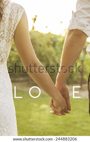 Portrait of young wedding couple, back view, outdoor. Sunset. New family. Cute valentine's message. Warm shades - stock photo