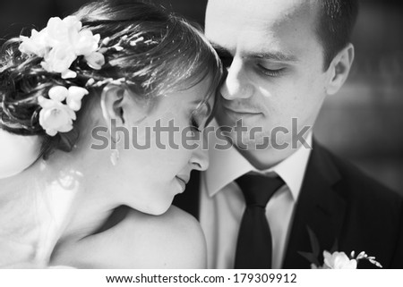 portrait of  young wedding couple in black and white