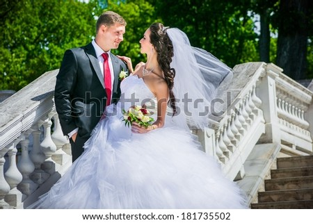 portrait of young wedding couple in park, beautiful bride with groom , summer nature outdoor