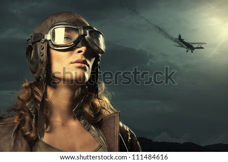 Portrait of young woman airplane pilot