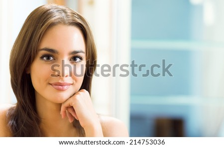 Portrait of young woman at home, with copyspace