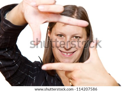 Portrait of young woman creates a frame with hands - stock photo