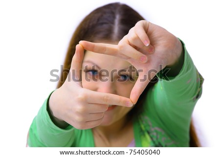 Portrait of young woman creates a frame with her hands. Isolated on white background - stock photo