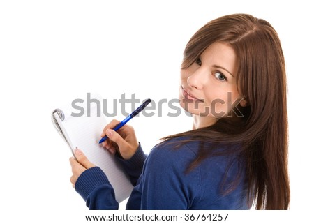 Portrait of young woman does records by pen in notepad isolated on white background