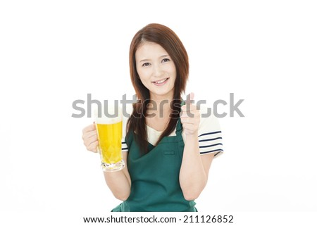 Portrait of young woman drinking beer.