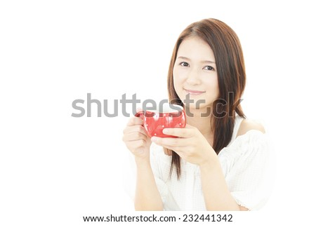 Portrait of young woman drinking cup of coffee.