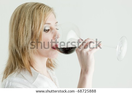 portrait of young woman drinking red wine - stock photo