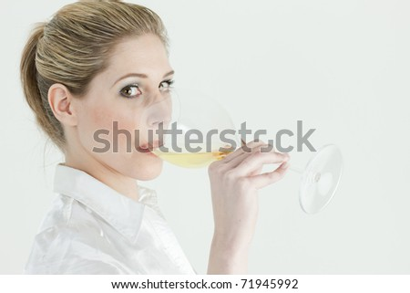 portrait of young woman drinking white wine - stock photo