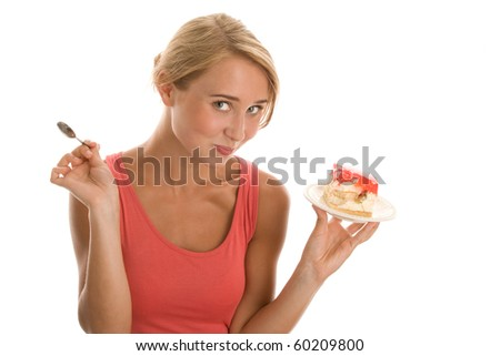 Portrait of young woman eating cake isolated on white background - stock photo