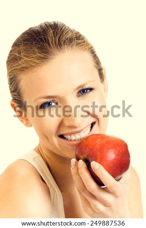 Portrait of young woman eating red apple, beauty and healthy eating concept. - stock photo