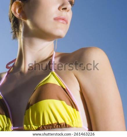 Portrait of young woman enjoying outdoors at the beach - stock photo