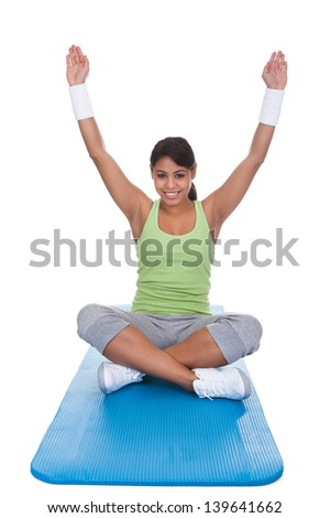 Portrait Of Young Woman Exercising Over White Background - stock photo
