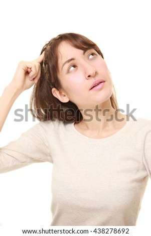 portrait of young woman has lost her memory - stock photo