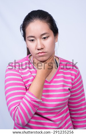 Portrait of young woman having a sore throat.
