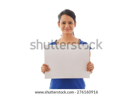 Portrait of young woman holding a white board - stock photo