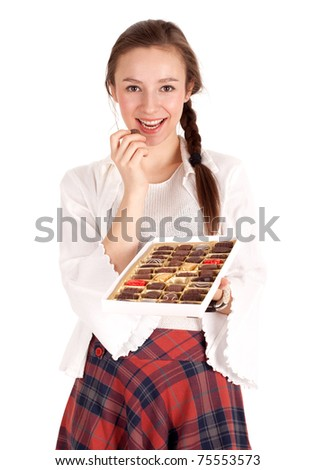 portrait of young woman holding chocolate box - stock photo