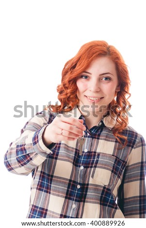 Portrait of young woman holding key isolated over white background