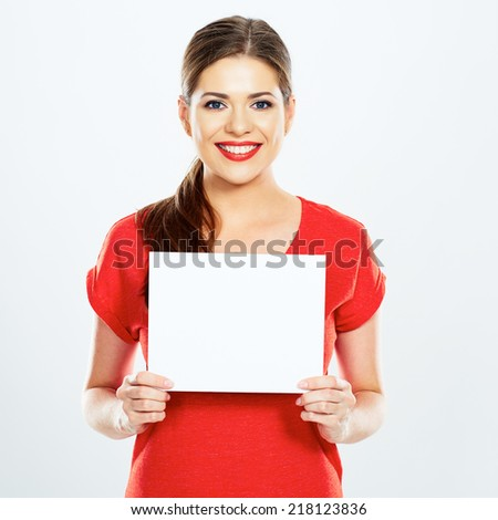 portrait of young woman holding sign card . white background . isolated . - stock photo