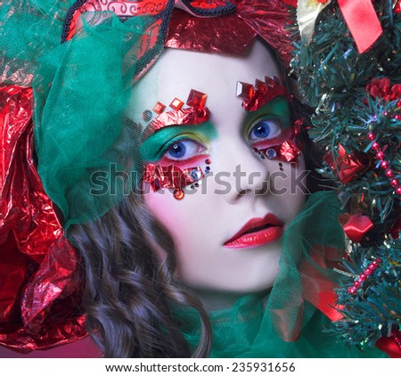 Portrait of young woman in artistic holiday image. - stock photo