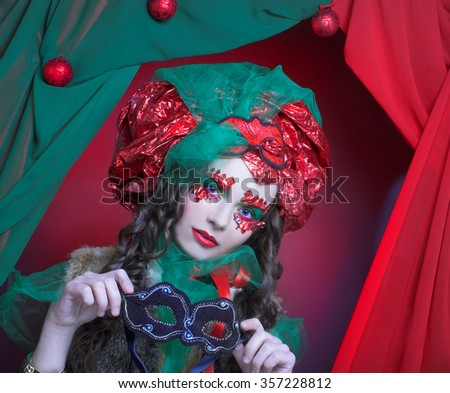 Portrait of young woman in artistic holiday image.