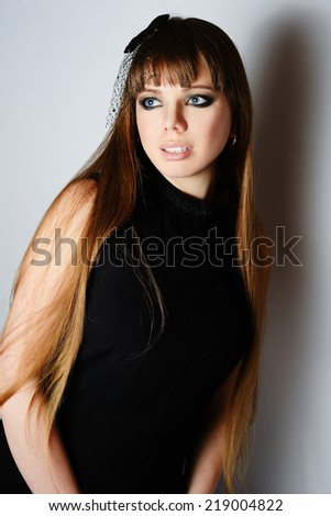 portrait of young woman in black - stock photo
