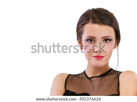 Portrait of young woman in black dress, isolated on white background. - stock photo