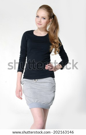 portrait of young woman in casual clothes posing - stock photo