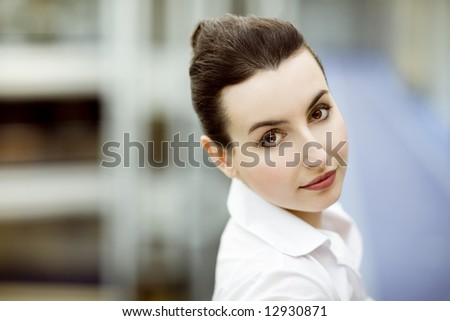 Portrait of young woman in modern office building enviroment - stock photo