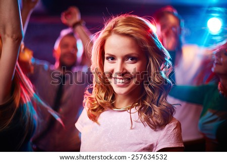 Portrait of young woman in nightclub - stock photo