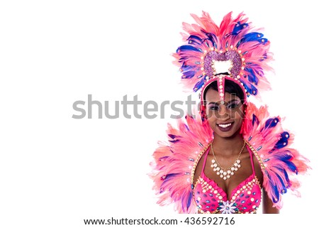Portrait of young woman in pink carnival costume