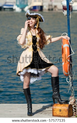 Portrait of young woman in pirate costume outdoors - stock photo