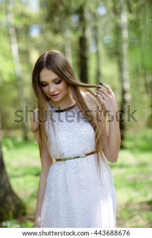 portrait of young woman in the forest