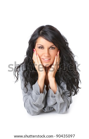Portrait of young woman laying on the floor with long hair, isolated over white background