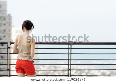 Portrait of young woman looking on city - stock photo