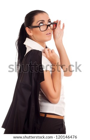 Portrait of young woman looking over glasses - stock photo