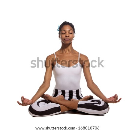 Portrait of young woman meditating in pose of lotus in isolation - stock photo
