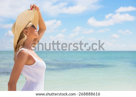 Portrait of young woman on the beach - stock photo