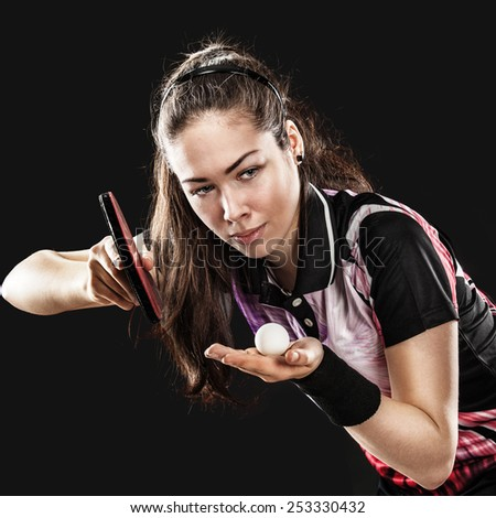 Portrait Of Young woman Playing Tennis On Black Background  - stock photo