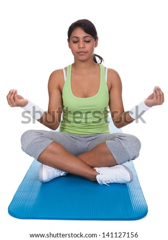 Portrait Of Young Woman Practicing Yoga Over White Background - stock photo