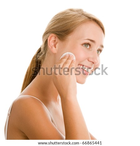 Portrait of young woman removing makeup - stock photo