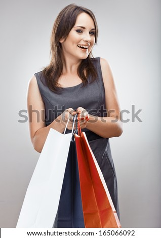 Portrait of young woman, shopping bag. Isolated studio background. Female model.