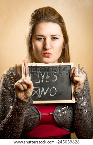 "Portrait of young woman showing checked box with answer ""no"" - stock photo"