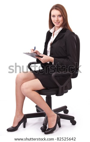 Portrait of young woman sitting on a chair. Isolated on a white background. - stock photo