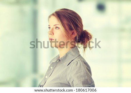 Portrait of young woman (student or businesswoman) - stock photo