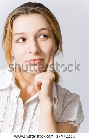 Portrait of young woman thinking about something nice - stock photo