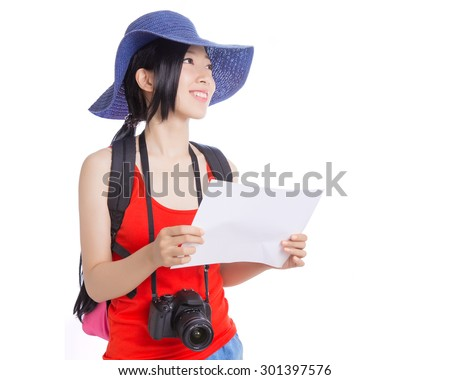 Portrait of young woman travelling - stock photo