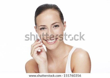Portrait of young woman using cotton pad